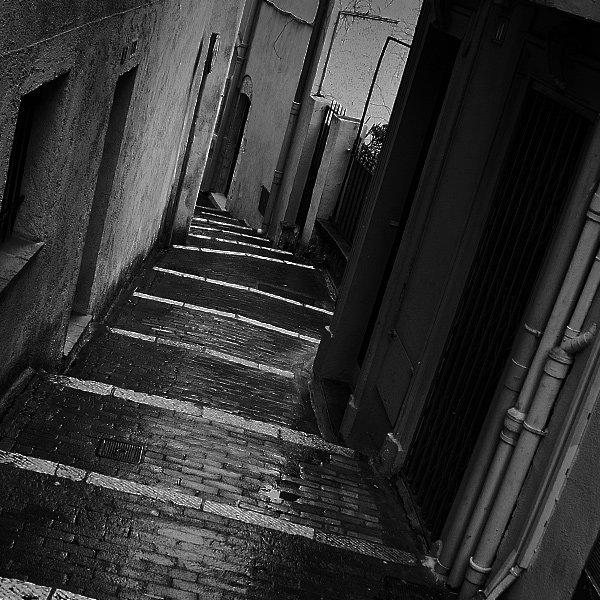 Black and white photo of an alley askew for style